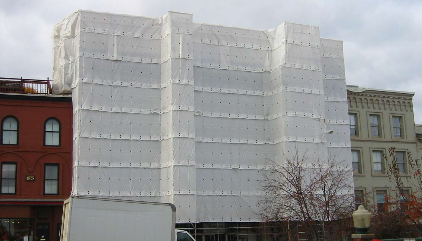 Scaffold Enclosure Systems for heat and cooling in New England